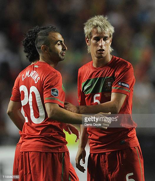 Fabio Coentrao of Portugal reacts with teammate Carlos Martins after Portugal beat Norway 10 in the EURO 2012 Group H qualifier between Portugal and...