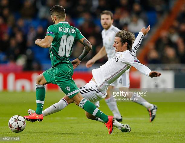 Fabio Coentrao of Real Madrid and Junior Caicara of Ludogorest pfc compete for the ball during the UEFA Champions League Group B match between Real...