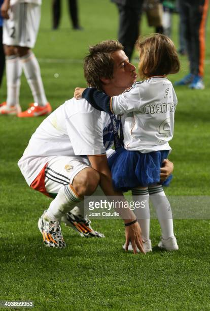 Fabio Coentrao of Real Madrid celebrates the victory with his daughter after the UEFA Champions League final between Real Madrid and Atletico de...