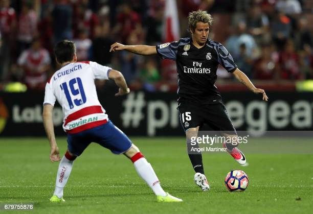 Fabio Coentrao of Real Madrid is challenged by Isaac Cuenca of Granada CF during the La Liga match between Granada CF and Real Madrid CF at Estadio...