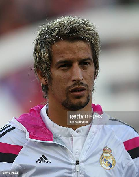 Fabio Coentrao of Real Madrid looks on during the UEFA Super Cup match between Real Madrid and Sevilla at Cardiff City Stadium on August 12 2014...