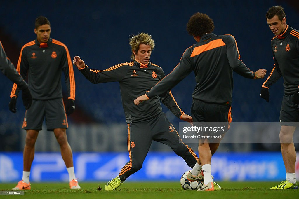 Fabio Coentrao of Real Madrid practices with team mates ahead of the Champions League match between FC Schalke 04 and Real Madrid at Veltins-Arena on February 25, 2014 in Gelsenkirchen, Germany.