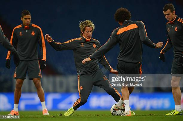 Fabio Coentrao of Real Madrid practices with team mates ahead of the Champions League match between FC Schalke 04 and Real Madrid at VeltinsArena on...