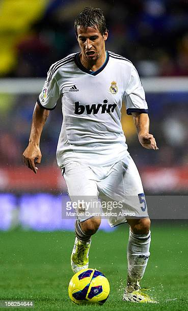 Fabio Coentrao of Real Madrid runs with the ball during the La Liga match between Levante UD and Real Madrid at Ciutat de Valencia on November 11...
