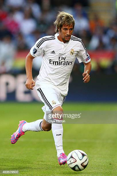 Fabio Coentrao of Real Madrid runs with the ball during the UEFA Super Cup between Real Madrid and Sevilla FC at Cardiff City Stadium on August 12...