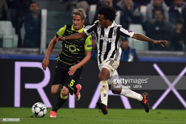 Fabio Coentrao of Sporting CP and Juan Cuadrado of Juventus compete for the ball during the UEFA Champions League group D match between Juventus and...