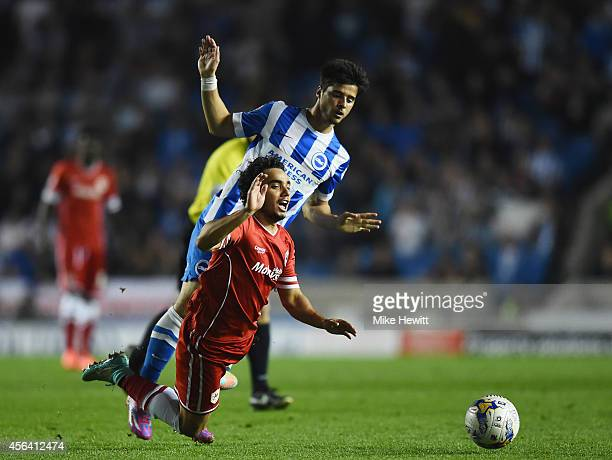 Fabio Da Silva of Cardiff is fouled by Jaoa Teixeira of Brighton during the Sky Bet Championship match between Brighton Hove Albion and Cardiff City...