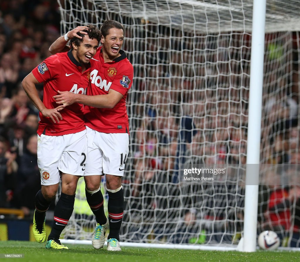 Fabio da Silva (L) of Manchester United celebrates scoring their fourth goal during the Capital One Cup Fourth Round match between Manchester United and Norwich City at Old Trafford on October 29, 2013 in Manchester, England.