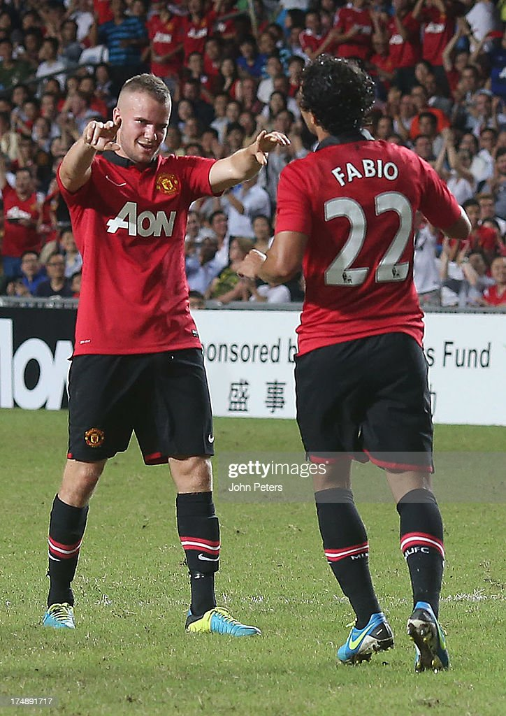 Fabio da Silva of Manchester United (R) celebrates scoring their second goal during the pre-season friendly match between Kitchee FC and Manchester United as part of their pre-season tour of Bangkok, Australia, Japan and Hong Kong at Hong Kong Stadium on July 29, 2013 in So Kon Po, Hong Kong.
