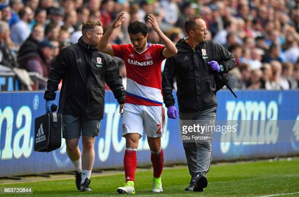 Fabio Da Silva of Middlesbrough comes off injured with the Middlesbrough medical team during the Premier League match between Swansea City and...