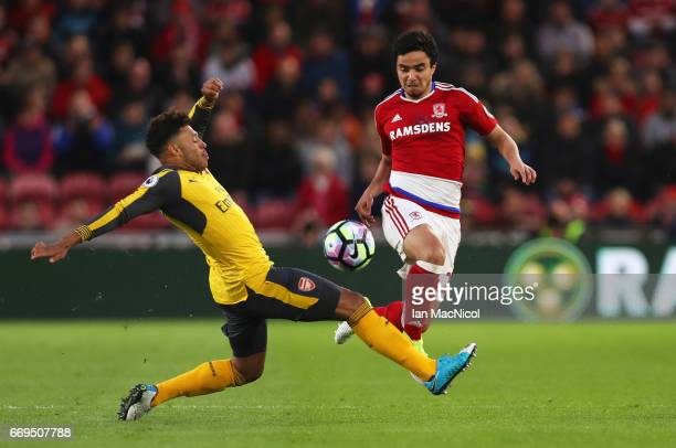 Fabio da Silva of Middlesbrough takes on Alex OxladeChamberlain of Arsenal during the Premier League match between Middlesbrough and Arsenal at...