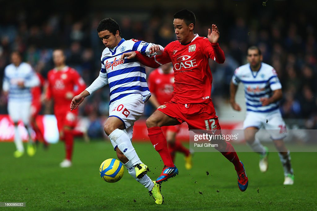 Fabio da Silva (L) of Queens Park Rangers holds off the challenge of Adam Chicksen (R) of Milton Keynes Dons during the FA Cup with Budweiser Fourth Round match between Queens Park Rangers and Milton Keynes Dons at Loftus Road on January 26, 2013 in London, England.