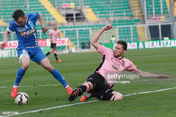 Fabio Daprelà of Palermo competes for the ball with Mario Rui of Empoli during the Serie A match between US Citta di Palermo and Empoli FC at Stadio...