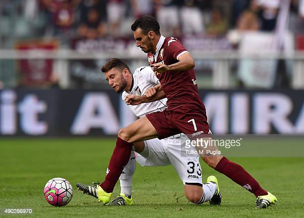 Fabio Daprela' of Palermo and Davide Zappacosta of Torino compete for the ball during the Serie A match between Torino FC and US Citta di Palermo at...