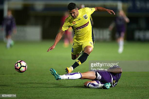 Fabio Ferreira of the Mariners contests the ball with Rhys Williams of the Glory during the round eight ALeague match between the Central Coast...