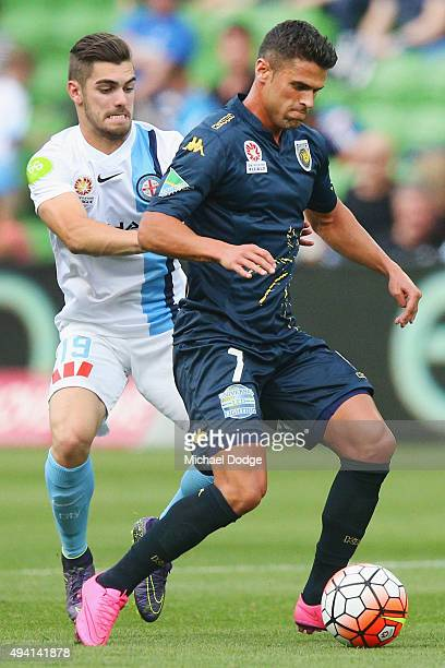 Fabio Ferreira of the Mariners controls the ball against Ben Garuccio of the City during the round three ALeague match between Melbourne City FC and...