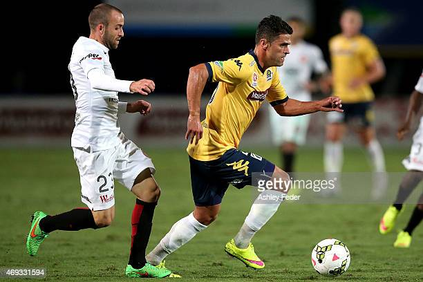 Fabio Ferreira of the Mariners controls the ball ahead of Jason Trifiro of the Wanderers during the round 25 ALeague match between the Central Coast...