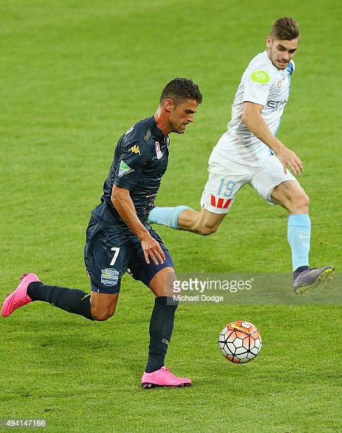 Fabio Ferreira of the Mariners runs with the ball next to Ben Garuccio of the City during the round three ALeague match between Melbourne City FC and...