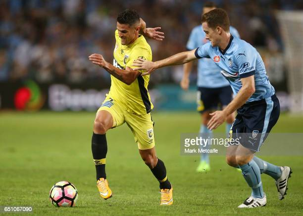 Fabio Ferreira of the Mariners takes on Brandon O'Neill of Sydney FC during the round 23 ALeague match between Sydney FC and the Central Coast...