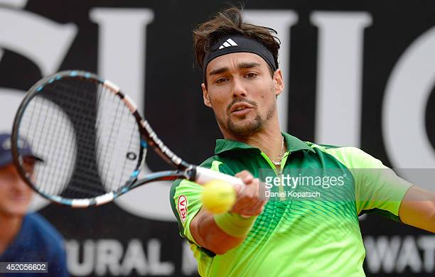 Fabio Fogini of Italy returns a shot during his singles match against Roberto Bautista Agut of Spain during day six of Mercedes Cup at TC Weissenhof...