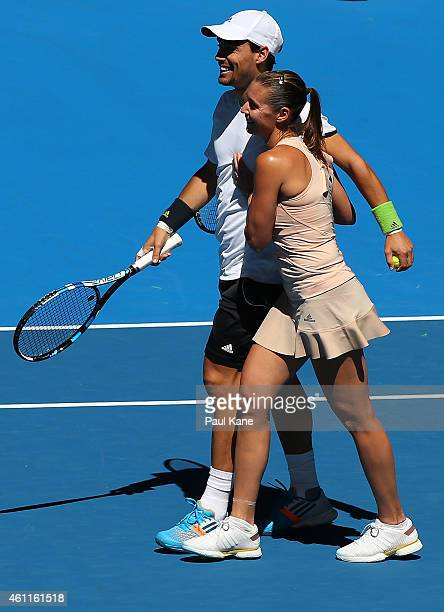 Fabio Fognini and Flavia Pennetta of Italy celebrate winning the mixed doubles match against Eugenie Bouchard and Vasek Pospisil of Canada during day...