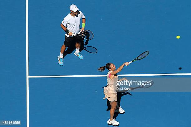 Fabio Fognini and Flavia Pennetta of Italy play the mixed doubles match against Eugenie Bouchard and Vasek Pospisil of Canada during day five of the...