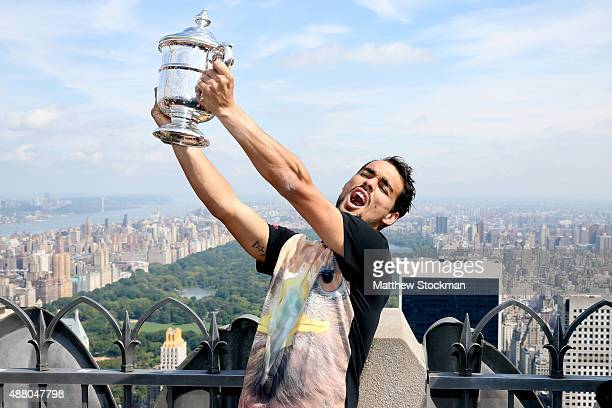 Fabio Fognini fiance of Flavia Pennetta of Italy the 2015 US Open Women's Singles champion poses with her winner's trophy at the Top of the Rock...