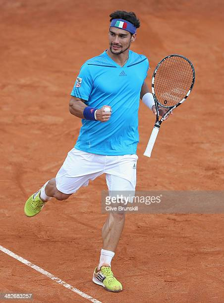 Fabio Fognini of Italy celebrates a point against James Ward of Great Britain during day one of the Davis Cup World Group Quarter Final match between...