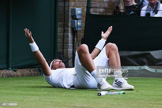 Fabio Fognini of Italy celebrates after winning his Gentlemen's Singles first round match against Alex Kuznetsov of the United States on day one of...