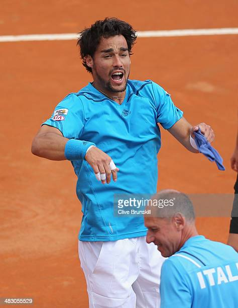 Fabio Fognini of Italy celebrates to the crowd after his straight sets victory against Andy Murray of Great Britain during day three of the Davis Cup...