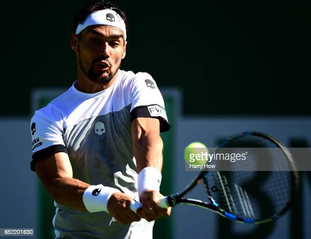 Fabio Fognini of Italy hits a backhand in his win over JoWilfried Tsonga of France during the BNP Paribas Open at Indian Wells Tennis Garden on March...