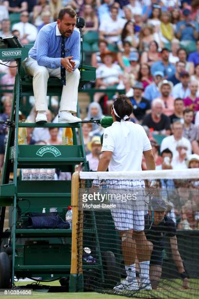 Fabio Fognini of Italy in discussion with the umpire during the Gentlemen's Singles third round match against Andy Murray of Great Britain on day...