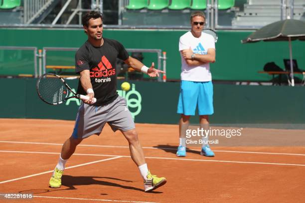 Fabio Fognini of Italy in practices volleys during a practice session prior to the Davis Cup World Group Quarter Final match between Italy and Great...