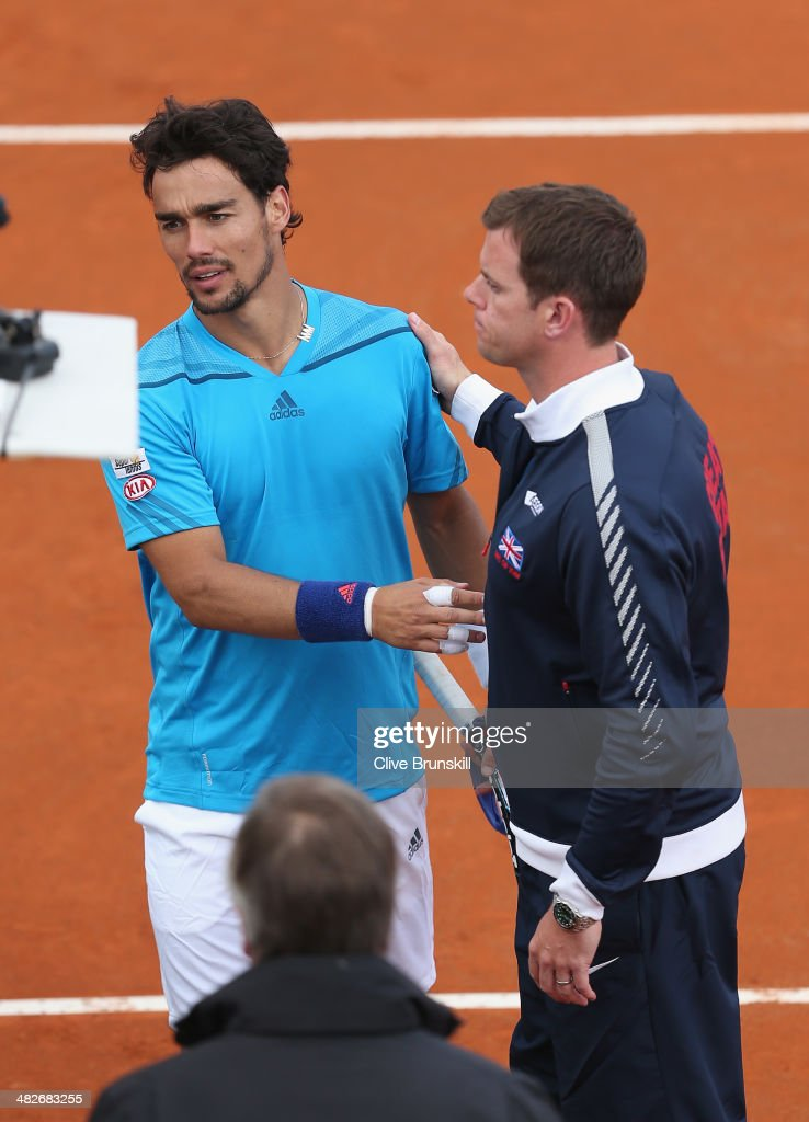 Fabio Fognini of Italy is congratulated by British team captain Leon Smith after his four set victory against James Ward of Great Britain during day one of the Davis Cup World Group Quarter Final match between Italy and Great Britain at Tennis Club Napoli on April 4, 2014 in Naples, Italy.