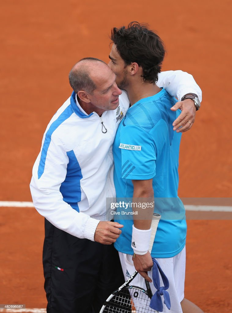 Fabio Fognini of Italy is congratulated by his team captain Carrado Barazzutti after his four set victory against James Ward of Great Britain during day one of the Davis Cup World Group Quarter Final match between Italy and Great Britain at Tennis Club Napoli on April 4, 2014 in Naples, Italy.