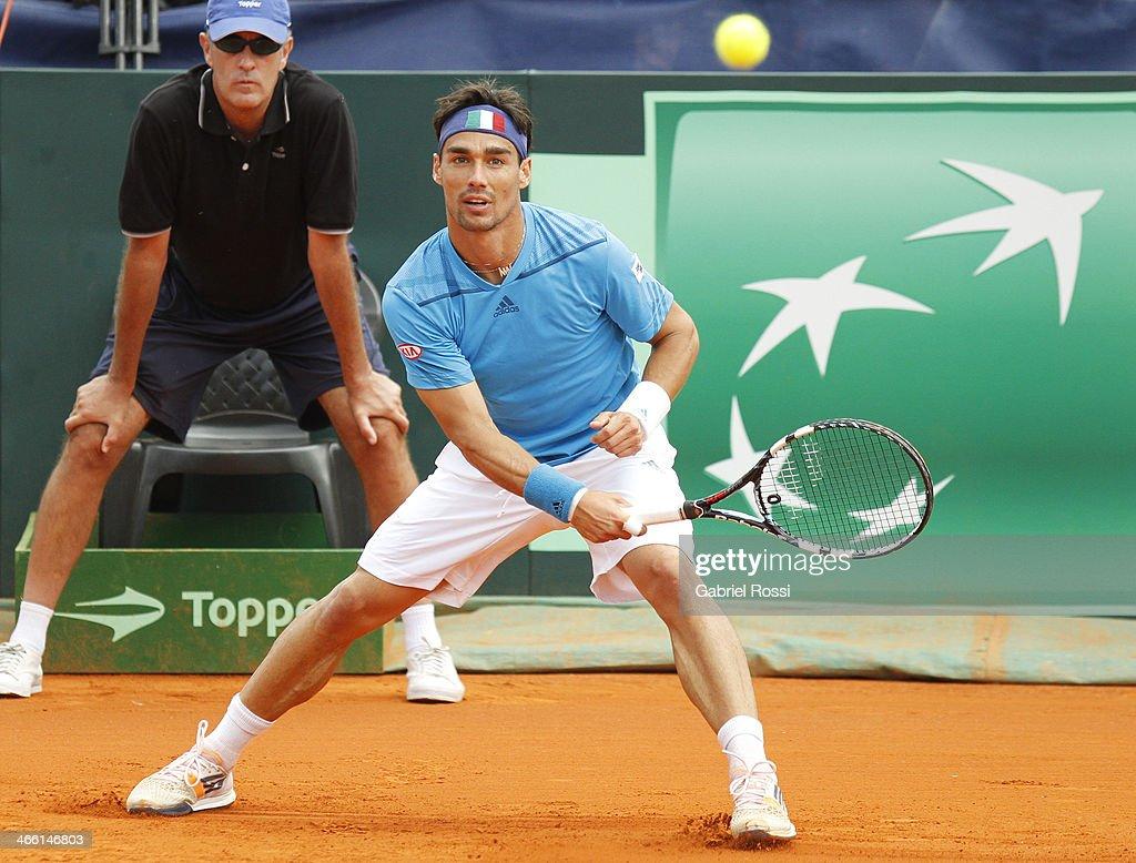 <a gi-track='captionPersonalityLinkClicked' href=/galleries/search?phrase=Fabio+Fognini&family=editorial&specificpeople=656601 ng-click='$event.stopPropagation()'>Fabio Fognini</a> of Italy makes a shot during a match between Argentina and Italy as part of the Davis Cup at Patinodromo Stadium on January 31, 2014 in Mar del Plata, Argentina.