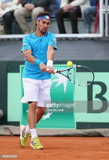 Fabio Fognini of Italy plays a backhand against James Ward of Great Britain during day one of the Davis Cup World Group Quarter Final match between...