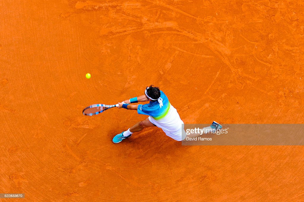 <a gi-track='captionPersonalityLinkClicked' href=/galleries/search?phrase=Fabio+Fognini&family=editorial&specificpeople=656601 ng-click='$event.stopPropagation()'>Fabio Fognini</a> of Italy plays a backhand against Viktor Troicki of Serbia during day four of the Barcelona Open Banc Sabadell at the Real Club de Tenis Barcelona on April 21, 2016 in Barcelona, Spain. Nishikori won 3-6, 5-7.