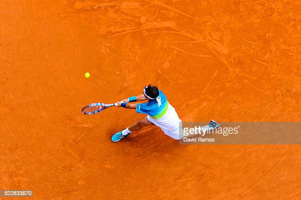 Fabio Fognini of Italy plays a backhand against Viktor Troicki of Serbia during day four of the Barcelona Open Banc Sabadell at the Real Club de...
