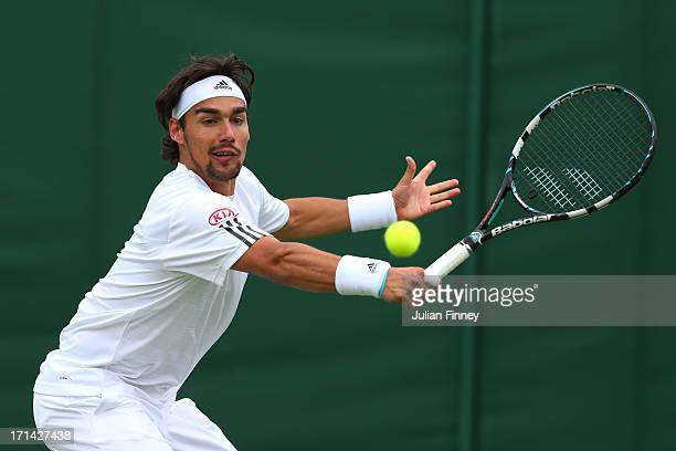 Fabio Fognini of Italy plays a backhand during his Gentleman's singles first round match against Jurgen Melzer of Austria on day one of the Wimbledon...