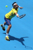 Fabio Fognini of Italy plays a backhand during his match against Milos Raonic of Canada during day three of the AAMI Classic at Kooyong on January 11...
