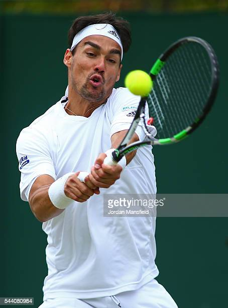 Fabio Fognini of Italy plays a backhand during the Men's Singles second round match against Feliciano Lopez of Spain on day five of the Wimbledon...