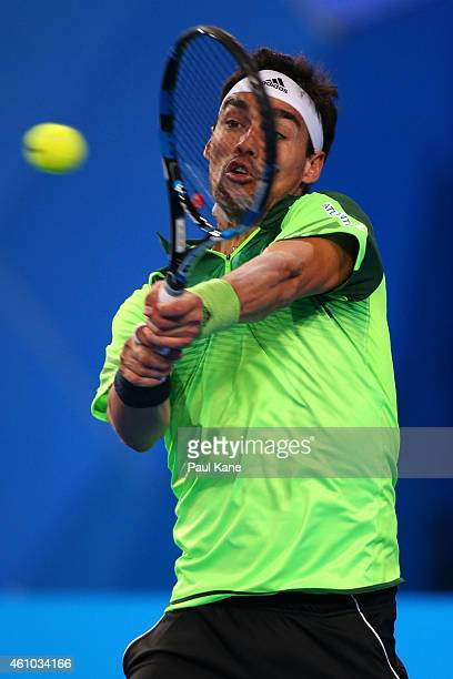 Fabio Fognini of Italy plays a backhand in his match against John Isner of the United States during day two of the 2015 Hopman Cup at Perth Arena on...