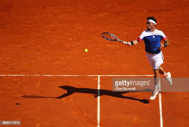 Fabio Fognini of Italy plays a forehand against Pablo Carreno Busta of Spain in their first round match on day two of the Monte Carlo Rolex Masters...