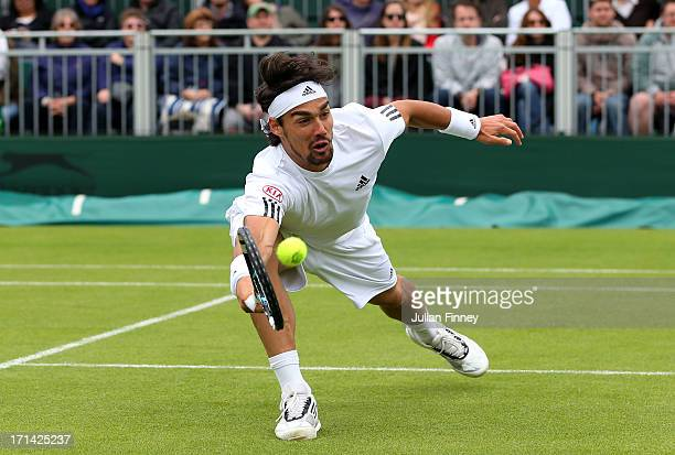 Fabio Fognini of Italy plays a forehand during his Gentleman's singles first round match against Jurgen Melzer of Austria on day one of the Wimbledon...