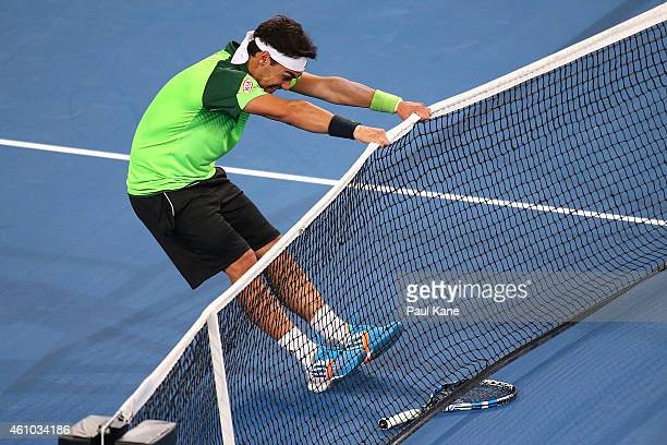 Fabio Fognini of Italy reacts after missing a shot in his match against John Isner of the United States during day two of the 2015 Hopman Cup at...
