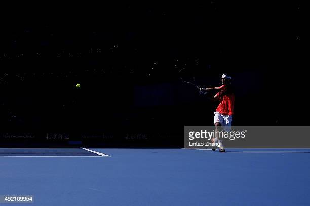 Fabio Fognini of Italy returns a shot against Rafael Nadal of Spain during the Men's singles semifinals match on day 8 of the 2015 China Open at the...