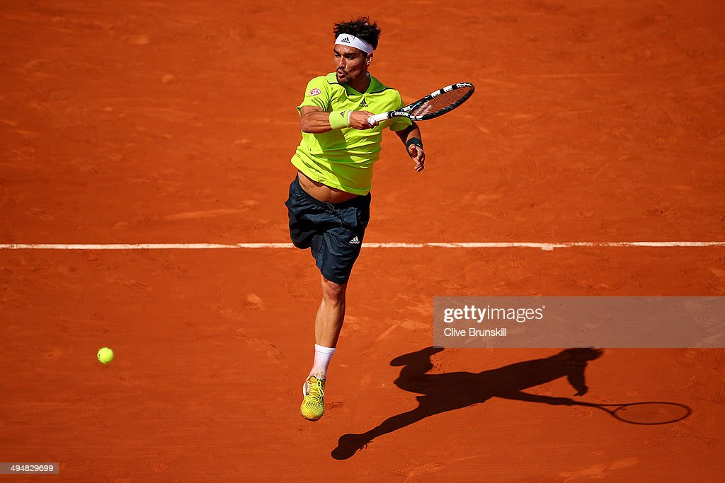 <a gi-track='captionPersonalityLinkClicked' href=/galleries/search?phrase=Fabio+Fognini&family=editorial&specificpeople=656601 ng-click='$event.stopPropagation()'>Fabio Fognini</a> of Italy returns a shot during his men's singles match against Gael Monfils of France on day seven of the French Open at Roland Garros on May 31, 2014 in Paris, France.