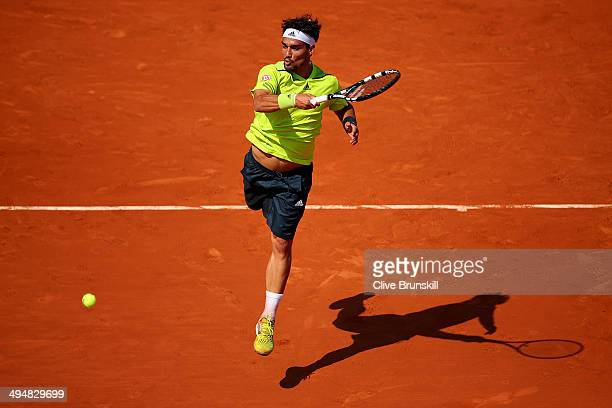 Fabio Fognini of Italy returns a shot during his men's singles match against Gael Monfils of France on day seven of the French Open at Roland Garros...
