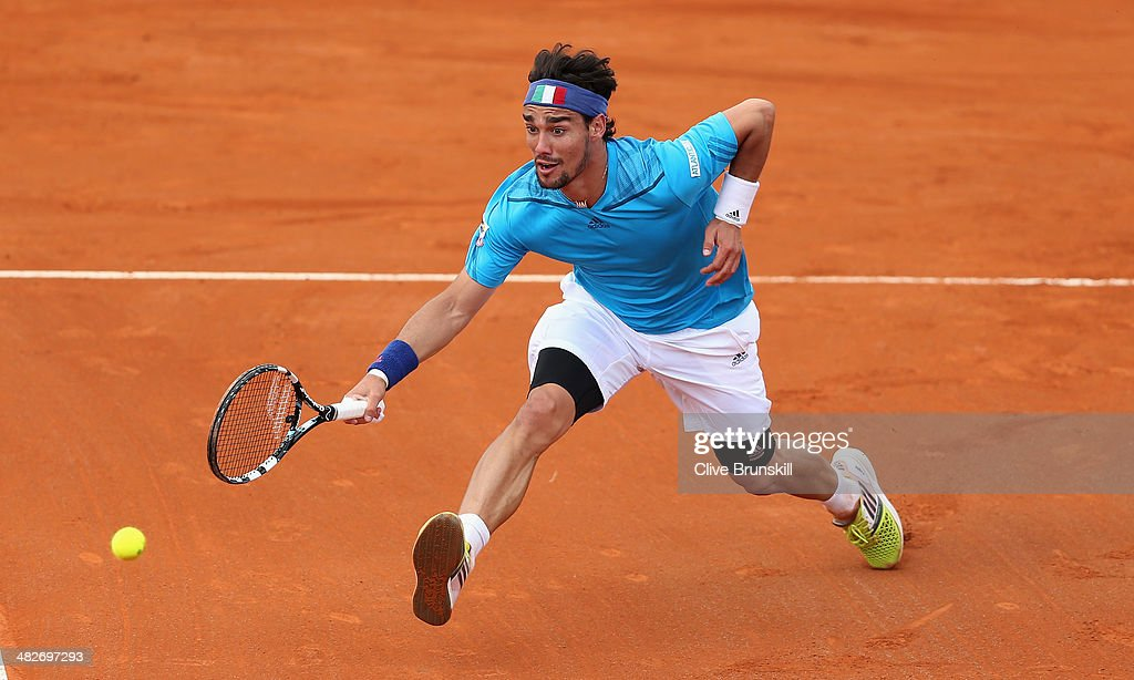 Fabio Fognini of Italy runs ro play a forehand volley against James Ward of Great Britain during day one of the Davis Cup World Group Quarter Final match between Italy and Great Britain at Tennis Club Napoli on April 4, 2014 in Naples, Italy.